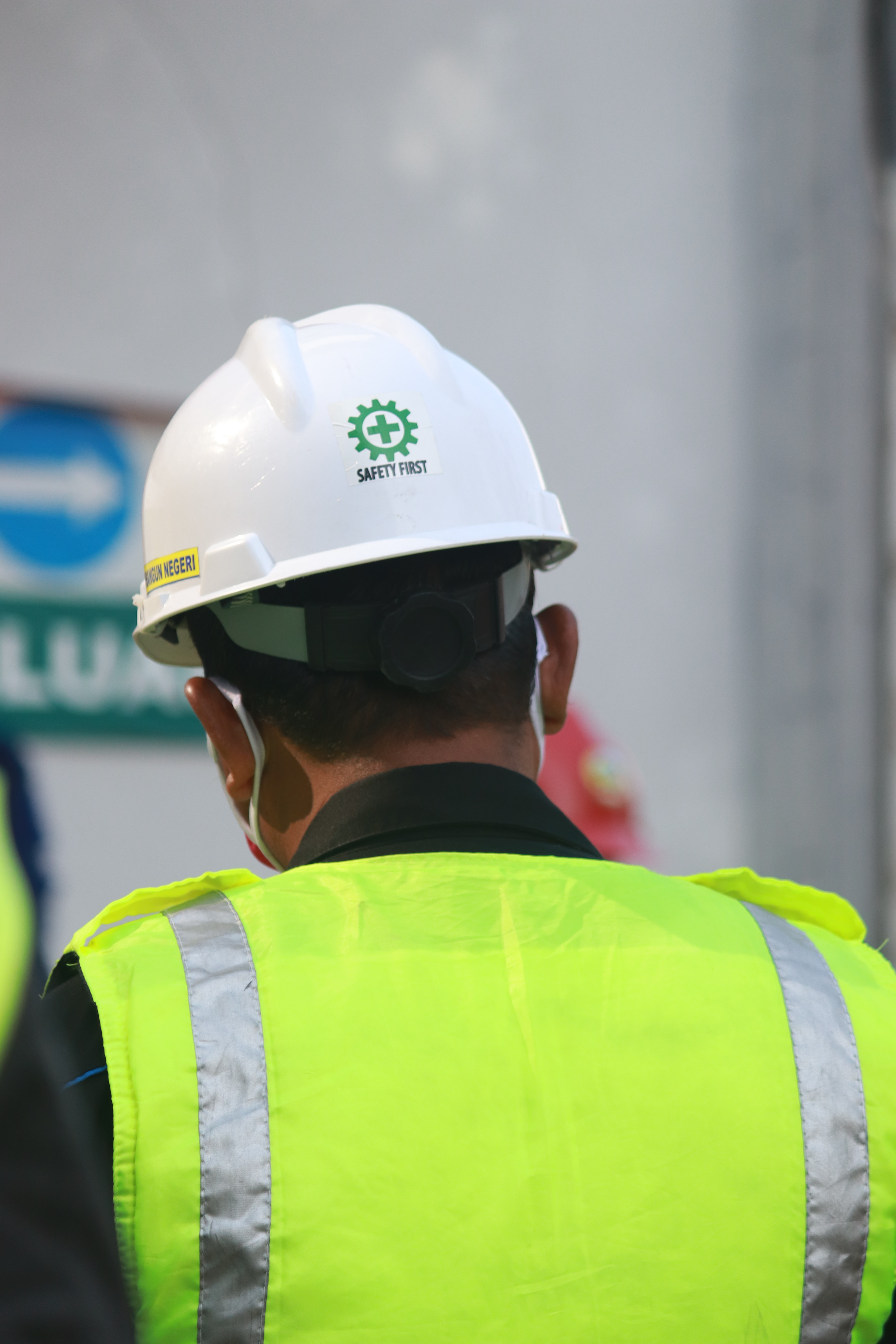 Green Span Profiles Why Your Commercial Project Should Exceed Building Code Construction Worker in Vest and Helmet
